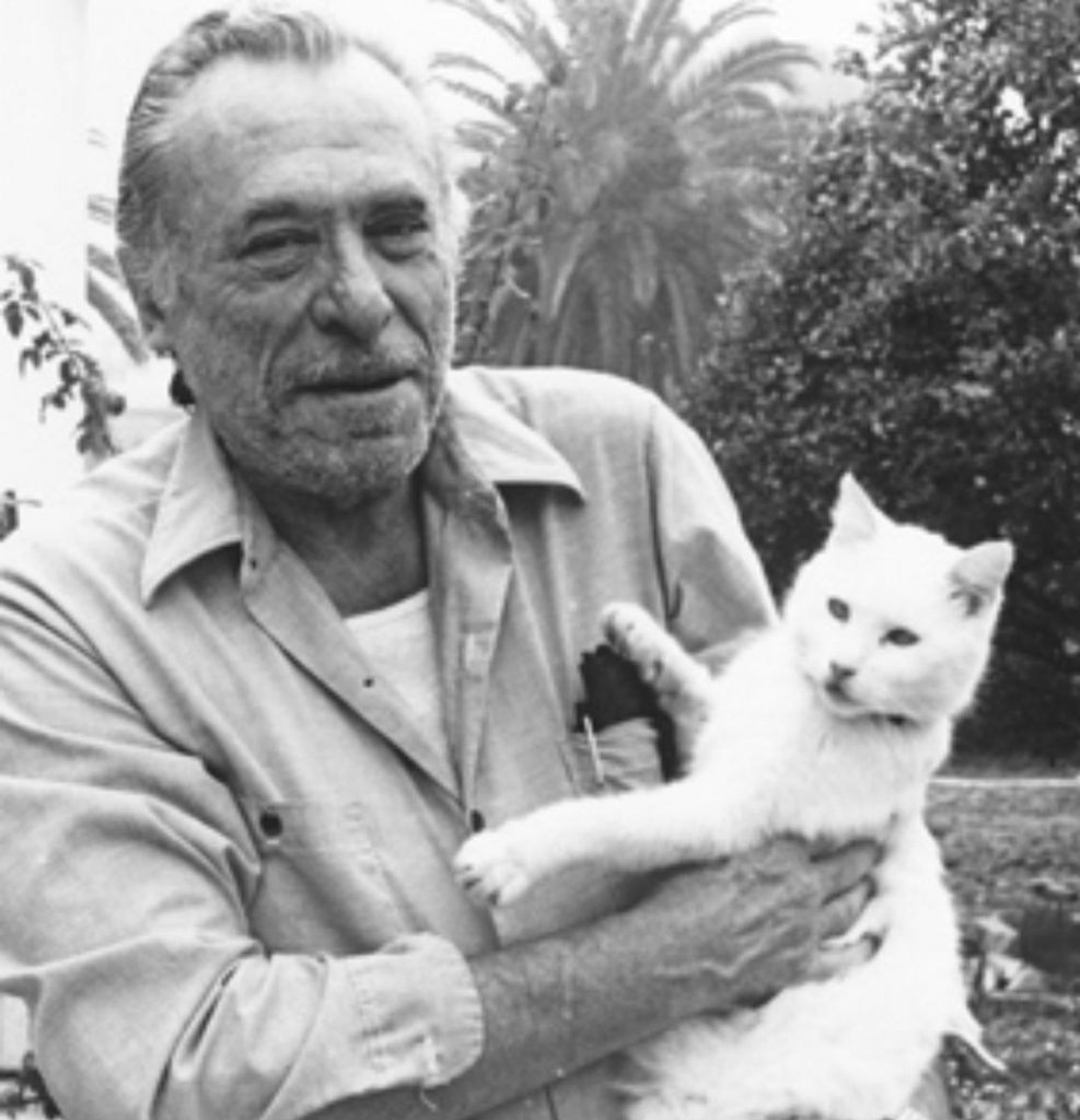 Charles Bukowski with white cat
